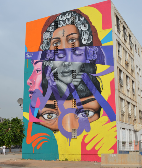 large mural of womens faces in different horizontal stripes