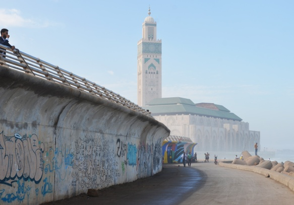 sea wall, with path below, beside the Atlantic Ocean in Casablanca, with Hassan 2 mosque in the background