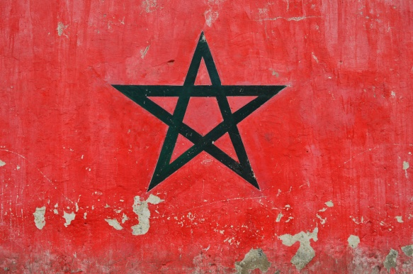 part of a series of murals on a Casablanca wall, a green star on a red background