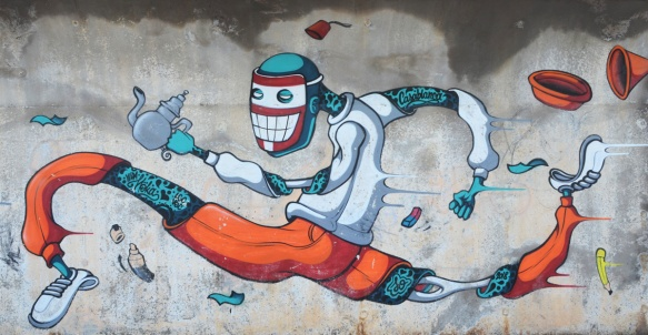 mural by vida moka of a topless man with orange pants, mask over face, teapot in one hand, running,