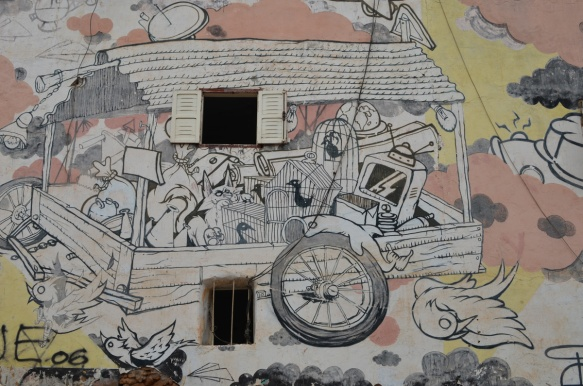 detailed painting of a wagon full of stuff, mural on a casablanca wall