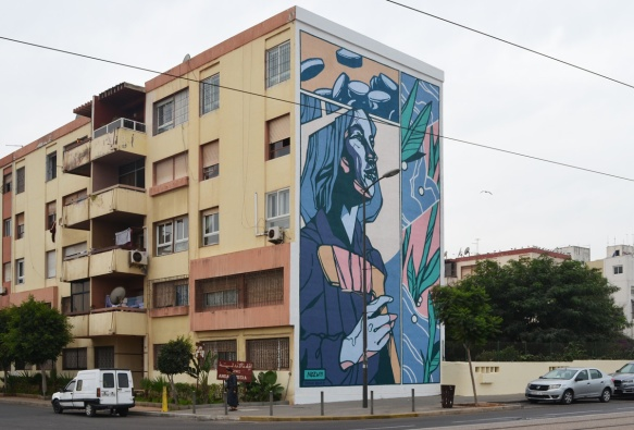 large mural by ndzw on the side of a Casablanca residential building in Derb Ghallef