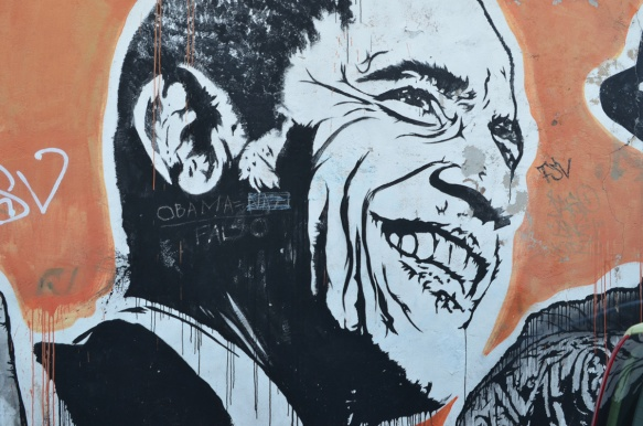Barak Obama, large portraits by sten and lex, Italian street arts, in a mural on two sides of the street, of famous people and common people,