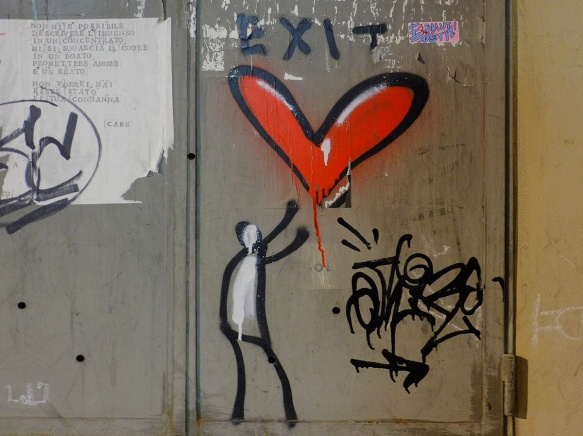 simple graffiti of a black stick figure with white filled in, reaching up to a red heart, with the word exit written above it