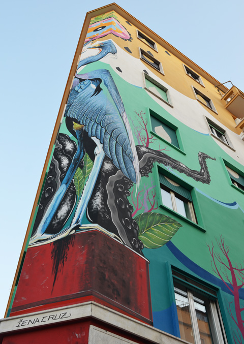 Lower part of a large mural called Hunting Pollution by Federico Massa also known as Iena Cruz, of a heron