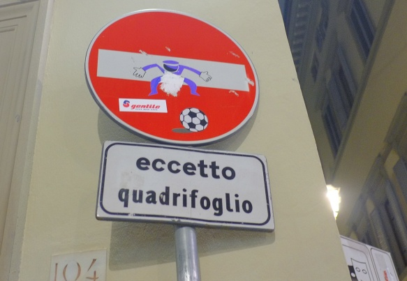 altered red and white no entry sign, graffiti by Clet Abraham, of a football goalie defending his net