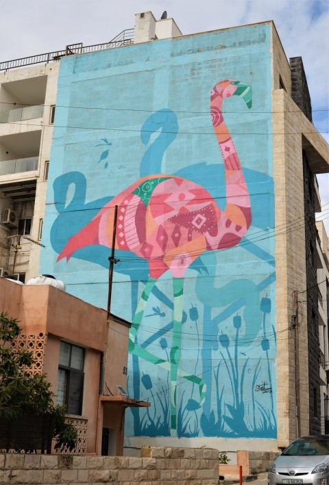 pink flamingo on turquoise background, a mural