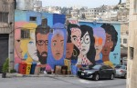 mural of a line of large faces of different ethnic backgrounds, and colours,