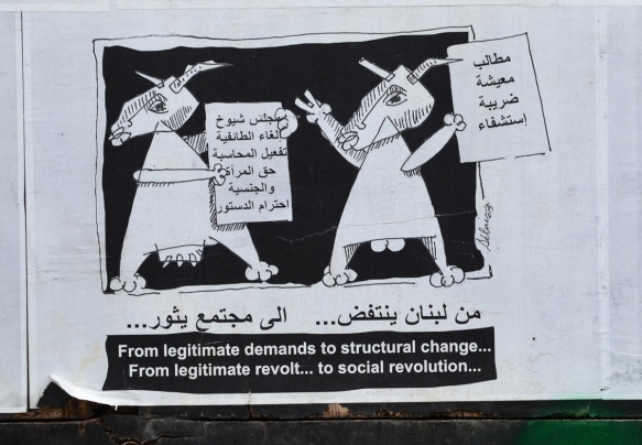 one of a series of panels with black and white illustrations plus words in both Arabic and English, cows talking,