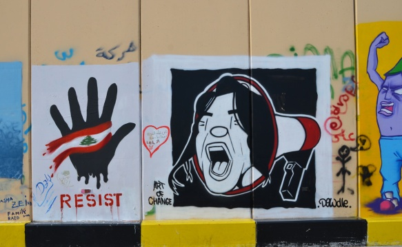 a black hand with a Lebanese flag over the palm beside a man's face, shouting with eyes closed, coming out of a megaphone, street art protest piece