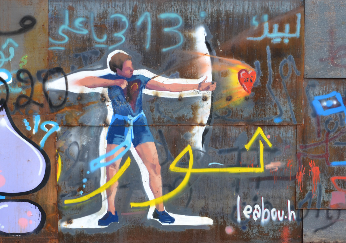 graffiti, an archer in blue top and shorts shoots a red heart from a bow