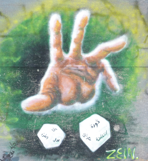 street art of a hand throwing a pair of dice