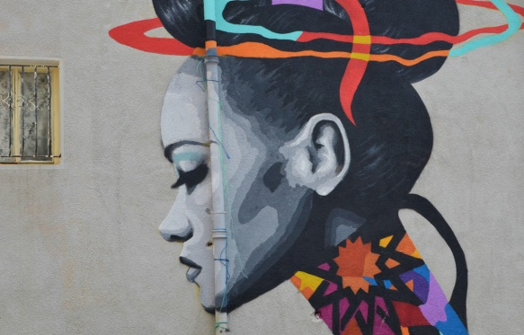 close up of the head, a woman in profile, in the mural painted by Dina Saadi