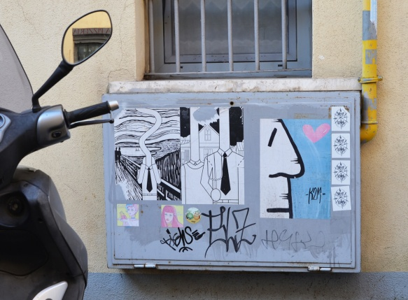 paste ups on a metal box in the street in Rome