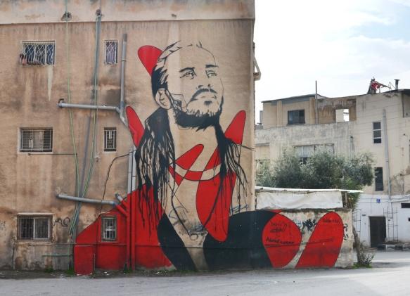 large mural in Al Hashmi Al Shamali in Amman of a man in black and red