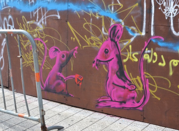 two pink mice painted on a wall in Beirut