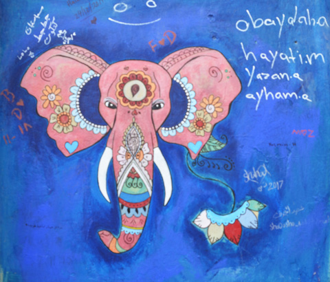 on a blue background, street art painting of pink elephant's head, frontal view, with Indian symbols on it