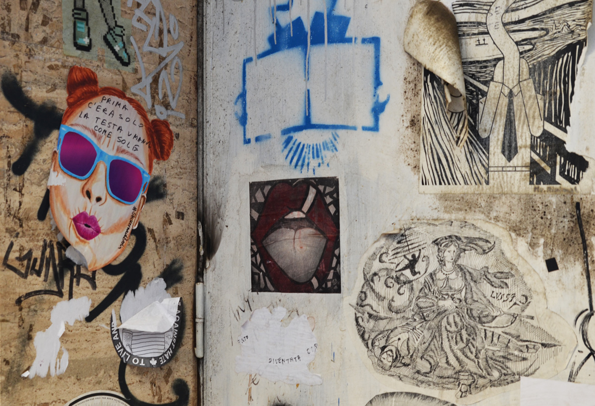 posters and stencils on a wall