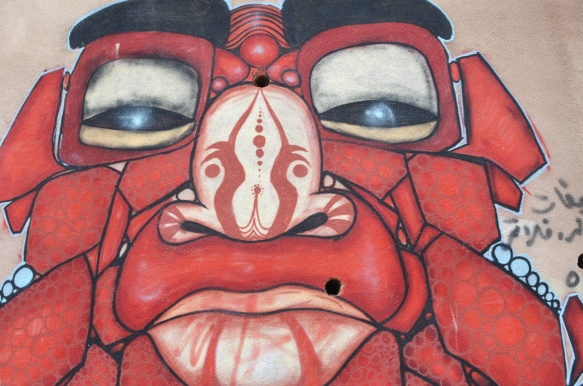 red monster face painted on a wall