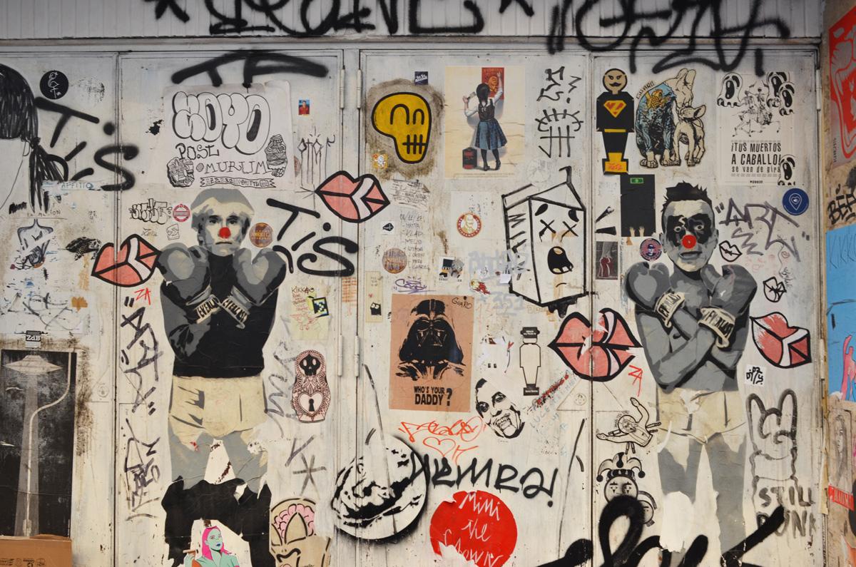 many slaps, stickers, etc, on a wall