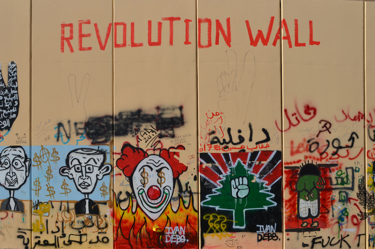 revolution wall, title of all the street art collection, on escwa wall, protest art, Beirut, clown face, green tree, closed fist,