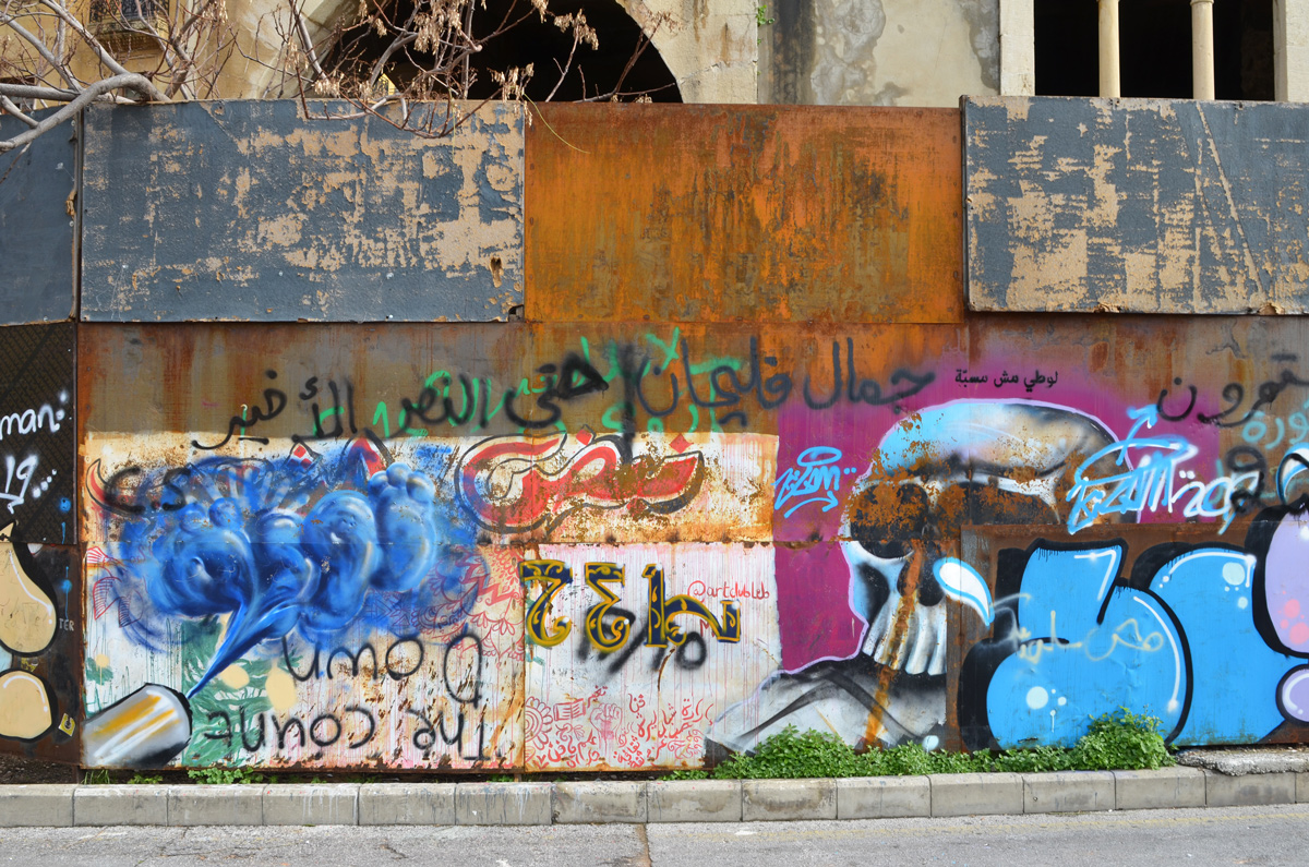street art and protest graffiti on a wall, exterior