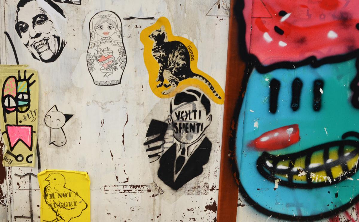 volti spenti graffiti as well as a babushka doll and a dinosaur