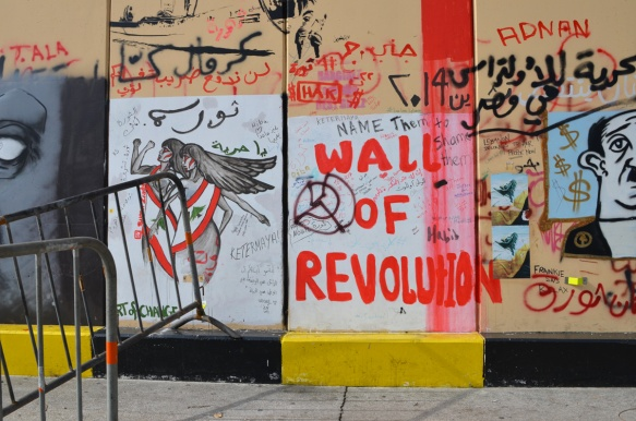 wall of revolution, text in red paint on a wall in Beirut, along with other graffiti