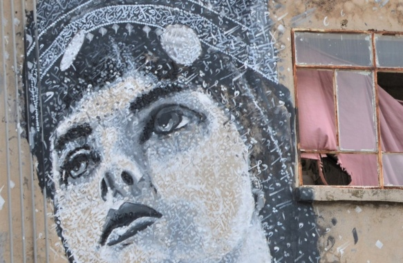 close up of face in mural of woman by Yazan halwani,