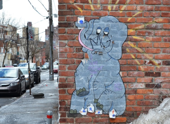 pasteup on a brick wall, a grey elephant drinking cans of beer with words about how he's not going to remember