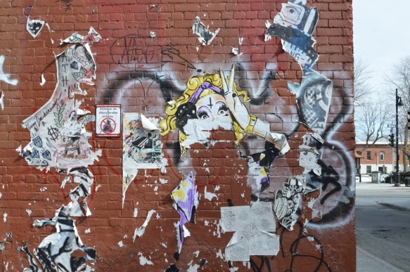 left over bits and pieces of paste ups on a wall, paper, torn, weathered,