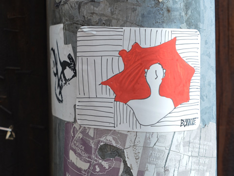 hand drawn sticker of a person's head and torso on a red background with black and white lines behind