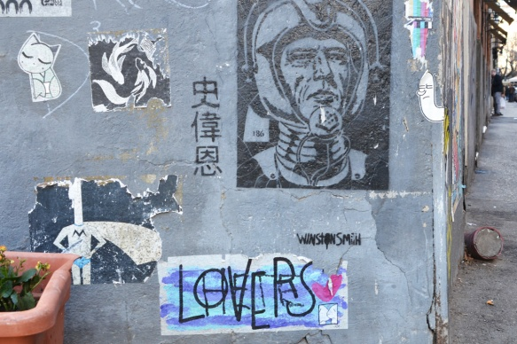 a black and white picture of a spaceman as well as a lovers paste up by K 2 M.
