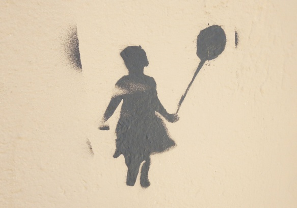 dark grey stencil of a giirl holding a balloon