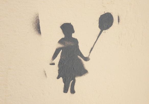 dark grey stencil of a giirl holding a balloon