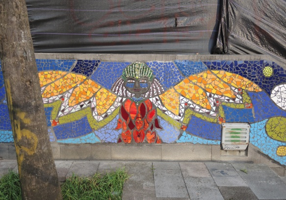 mosaic of a person with bridght yellow wings